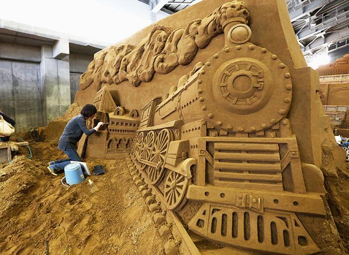 Песчаных дел скульптор