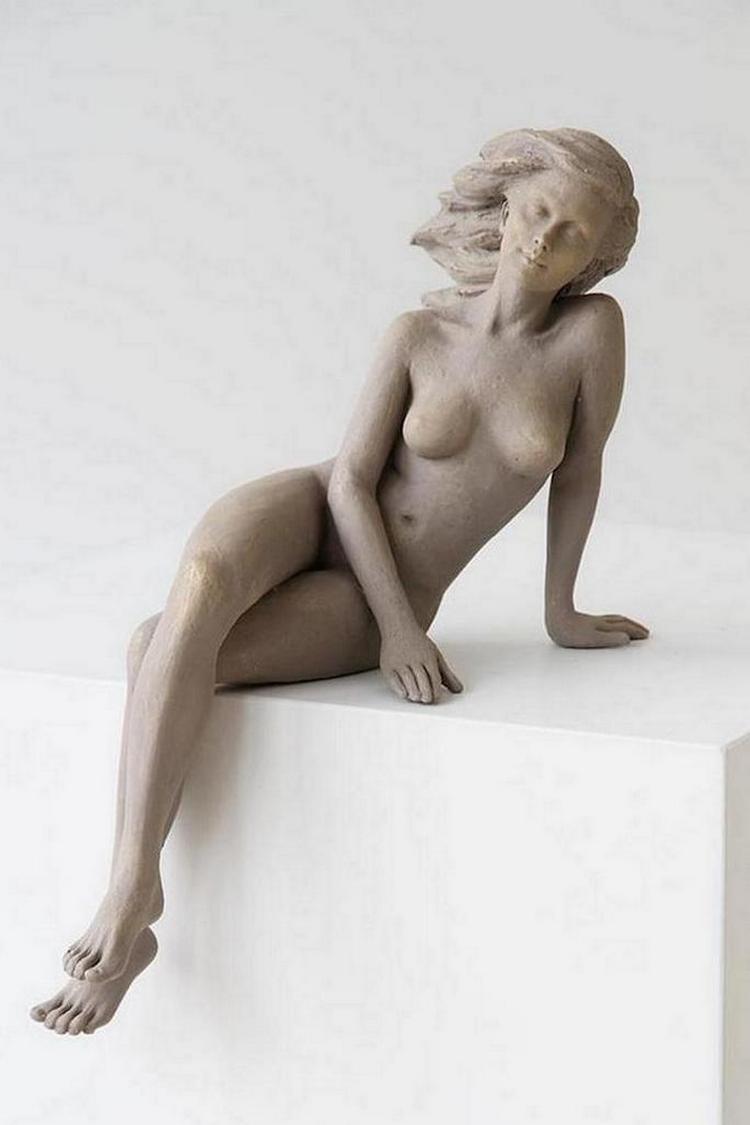 kitajskij-skulptor-lepit-zhenshhin1105