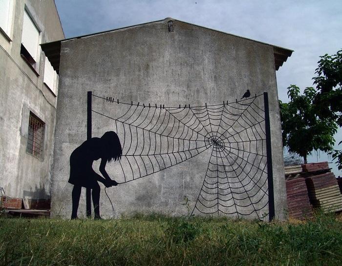 Захватывающий стрит-арт испанского художника Педжак (Pejac) в Саламанке, Испания.